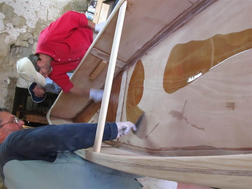 fetting epoxy out of containers gives much more time for coating the boat: storerboatplans.com