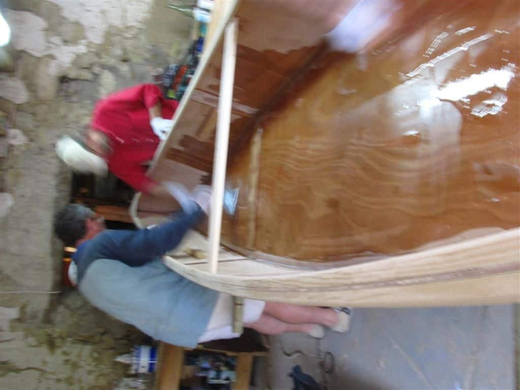epoxy is poured into boat and then roughly spread to give lots of working time: storer boatplans.com