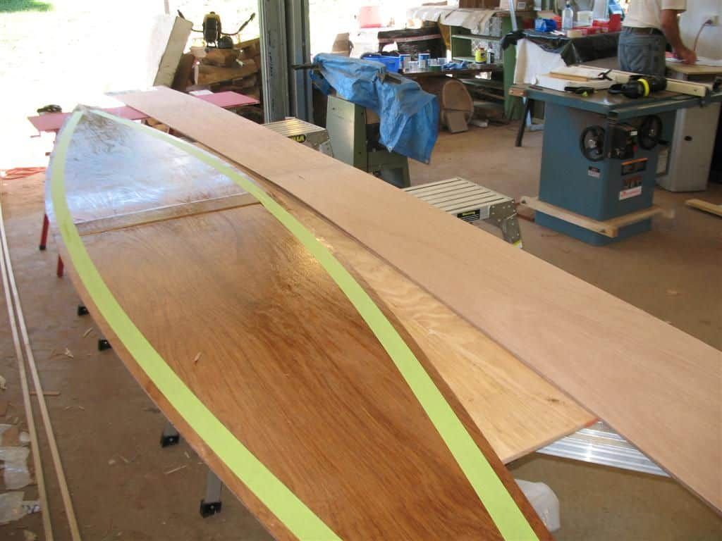 Precoated panels about to be assembled into canoe, quick canoe plan: storerboatplans.com