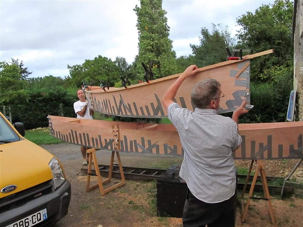 quick canoe assembled with duct tape - tough enough to carry and move around before epoxying. storer boat plans