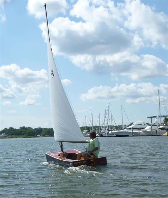 http://www.storerboatplans.com/wp/wooden-boat-plans/mark-milams-spectacularly-gorgeous-wooden-duck-an-ozracer-sailboat-bubinga-and-cypress/