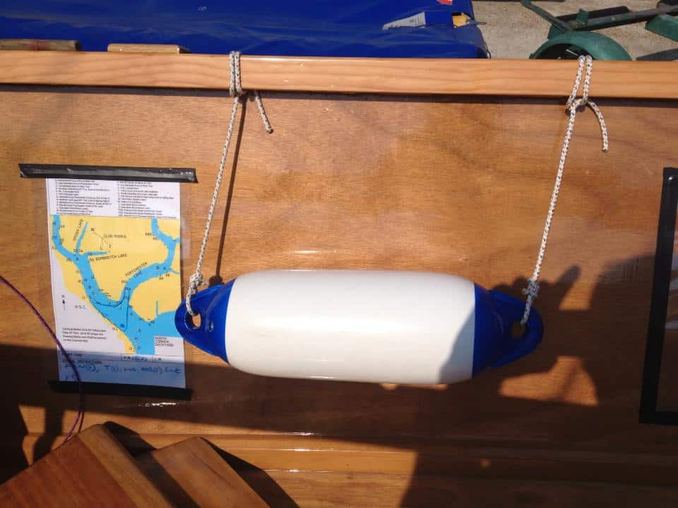 Using a fender as a dry comfortable seat in a fast dinghy with spaced gunwales - Goat Island Skiff Plan