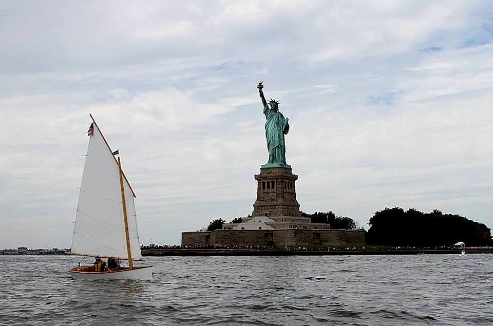 Goat Island Skiff self build sailboat and statue of liberty - plywood and epoxy