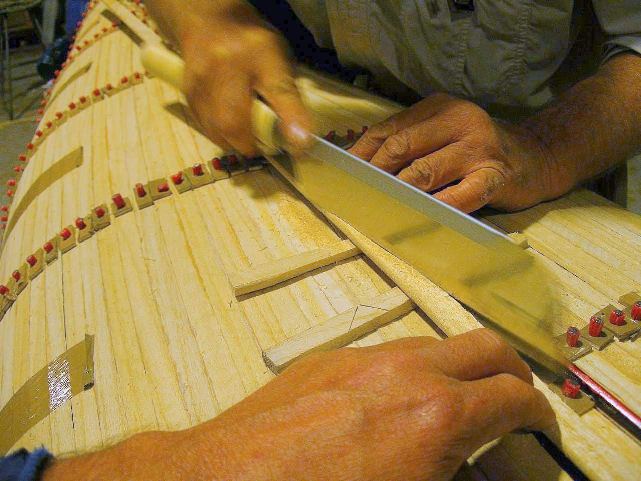 Trimming Paulownia timber strips along centreline of canoe or kayak. storer boat plans