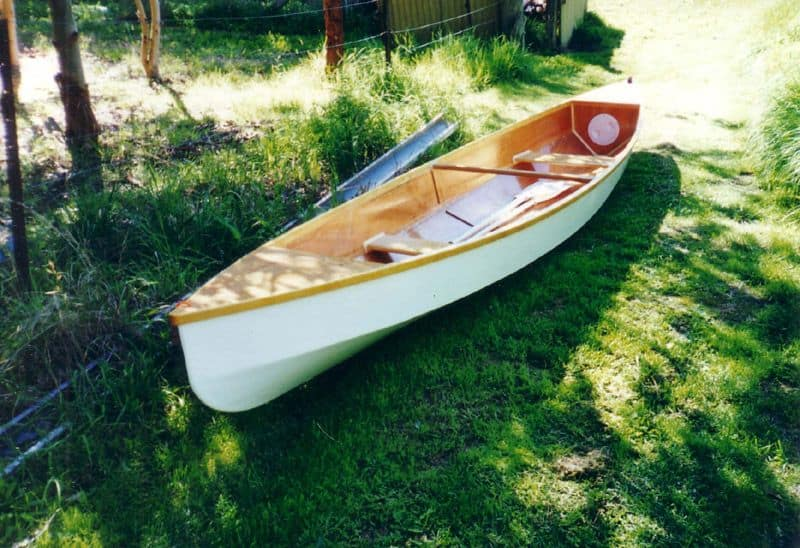 White Eureka stitch and glue lightweight canoe. storerboatplans.com
