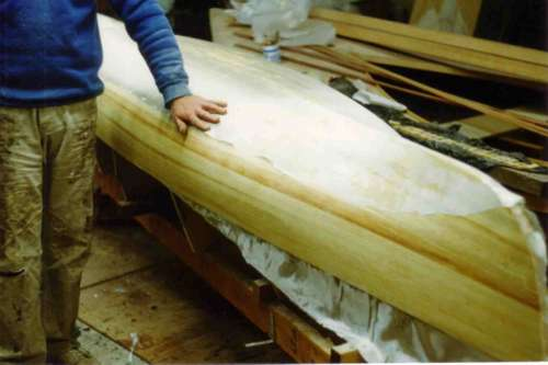 Very light glass is the best way to save weight on strip planked canoes and kayaks: storerboatplans.com