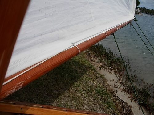Lacing a sail to a spar on a lug rigged Goat Island Skiff: storerboatplans.com